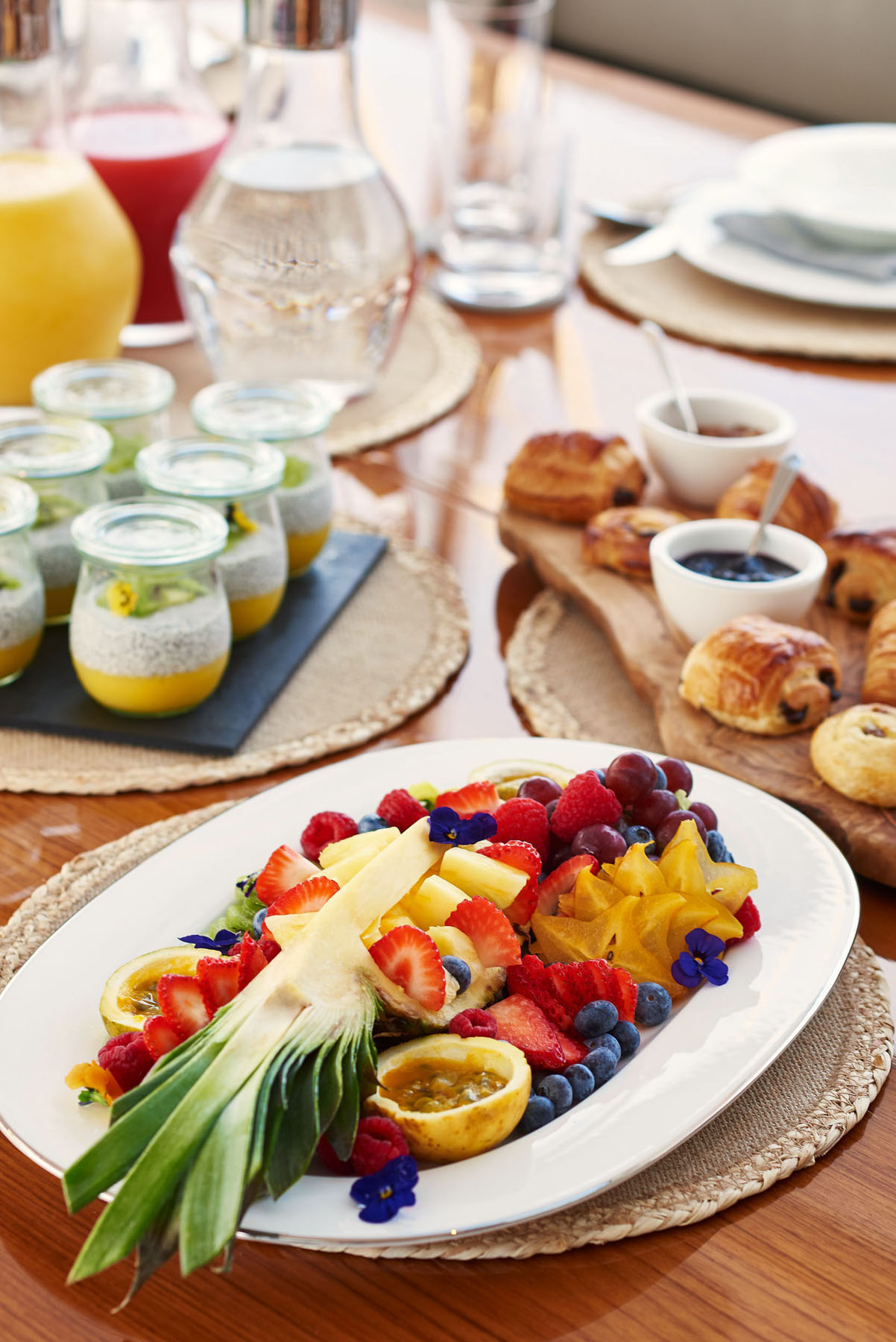 Breakfast on a super yacht. Fresh exotic fruit, pastries and juices.