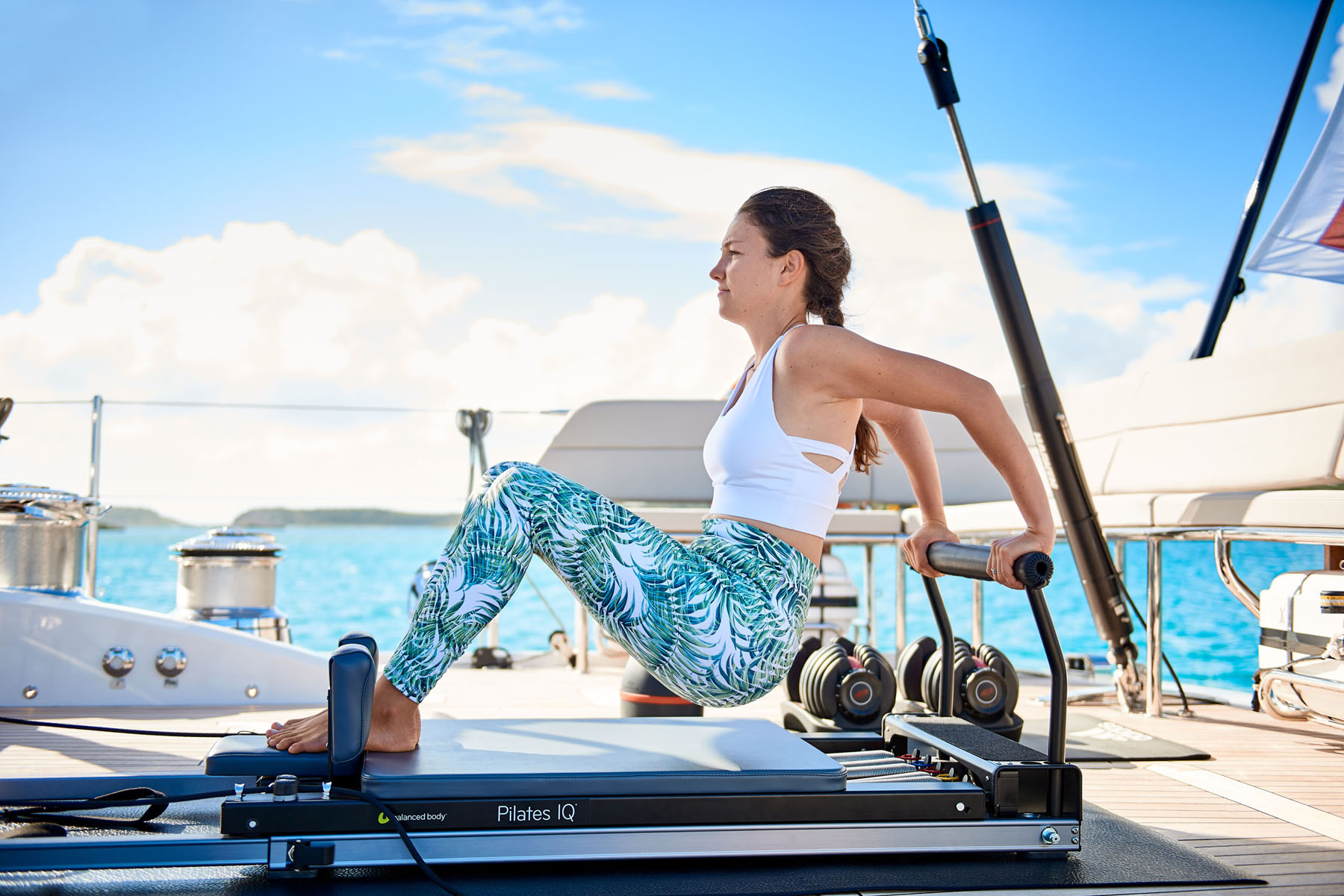 Exercising on a pilates machine onboard a yacht in the Caribbean