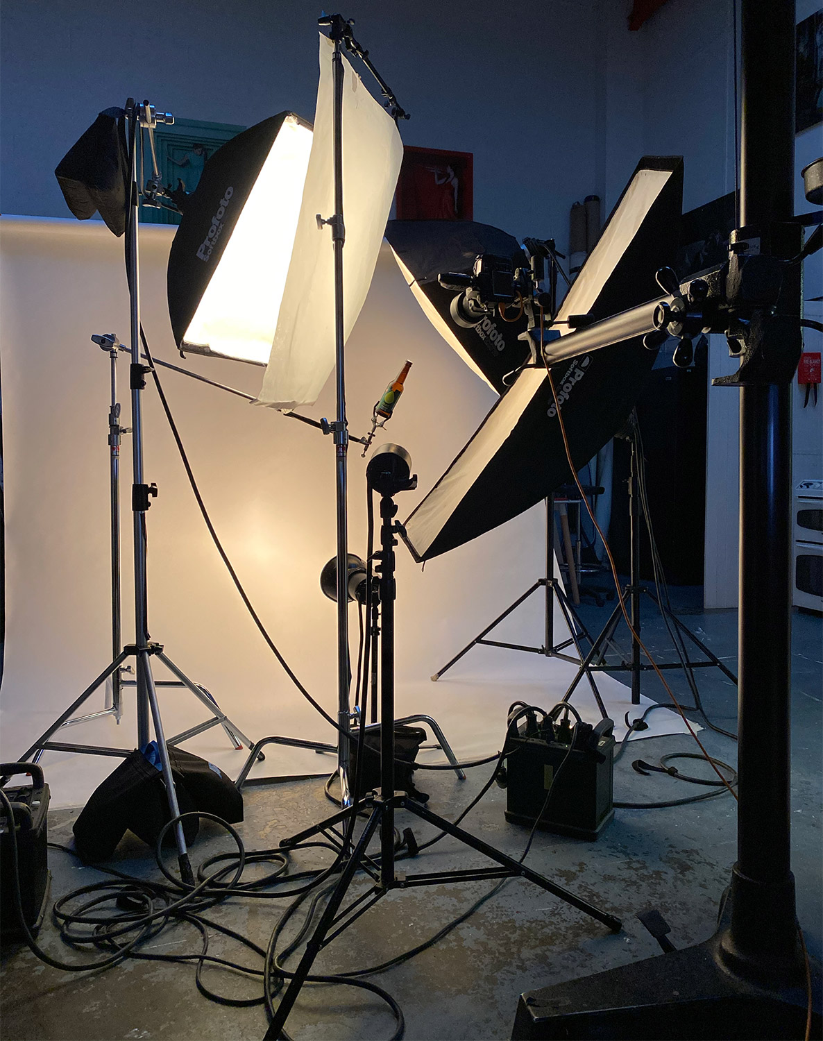 Behind the scenes on a beer photo shoot, showing lights and studio